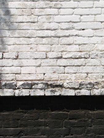 Foto de The brick texture with cracks and scratches as a background - Imagen libre de derechos
