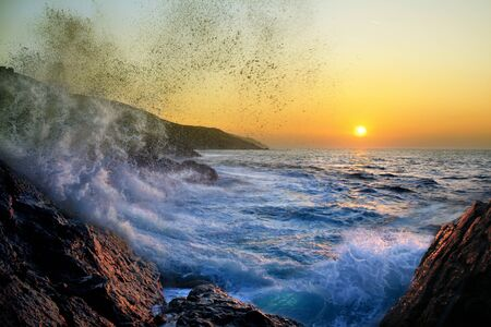 Photo pour Lets stay a while longer, rough ocean at sunset, - image libre de droit