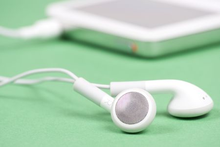 Close-up of MP3 player on green background