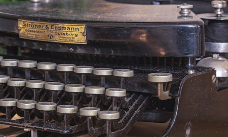Berlin, Germany - December 19, 2018: Detail of a historic dusty portable typewriter made in Germany during the twenties of the 20th century.