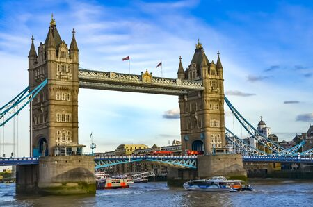 Photo for London, Great Britain - August 1, 2015: View to the Tower Bridge over the water with boats on a sunny day with a wonderful blue sky. - Royalty Free Image