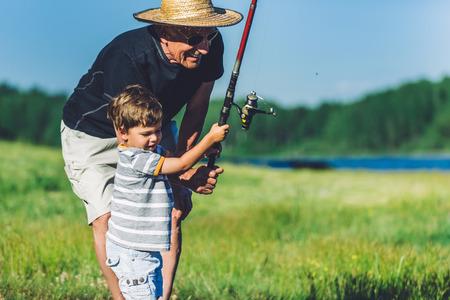 Photo pour Grandfather and grandson fishing and having fun - image libre de droit