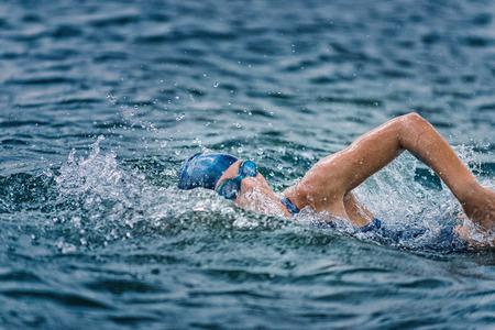 Photo pour Open water swimming - female athlete swimming long distance - image libre de droit