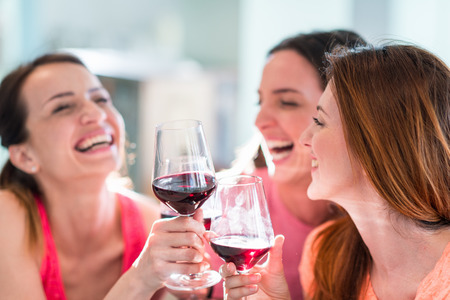 Photo for Friends drinking wine in restaurant - Royalty Free Image