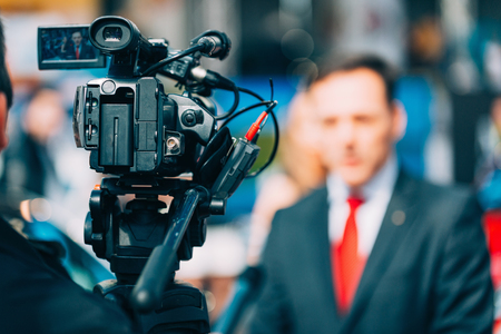 Photo pour Media interview on fair - image libre de droit