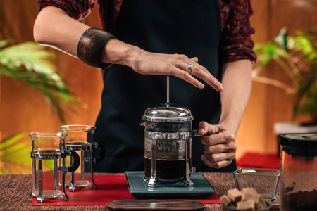 Photo pour Barista Making French Press Coffee. Close up image of hands female barista making French press coffee - image libre de droit