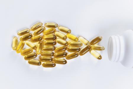 Photo pour Omega 3 supplements.  Softgel supplement capsules, fish shape - image libre de droit