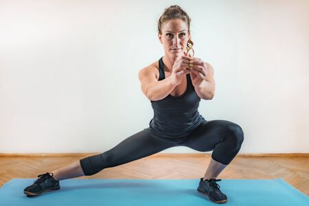 Foto de Side Lunges Exercise. HIIT or High Intensity Interval Training Indoor - Imagen libre de derechos