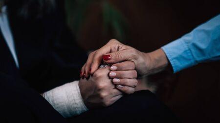 Photo pour Positive Psychology. Professional therapist holding patient's hand, enforcing flow of positive emotions - image libre de droit