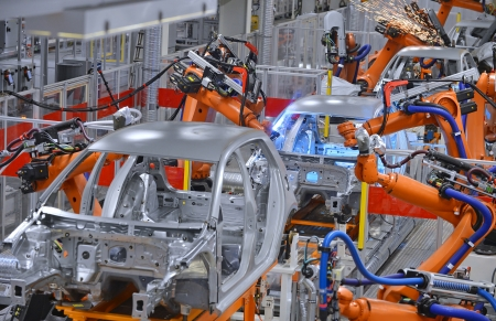 robots welding in an automobile factory