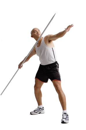 Young man preparing to throw javelin