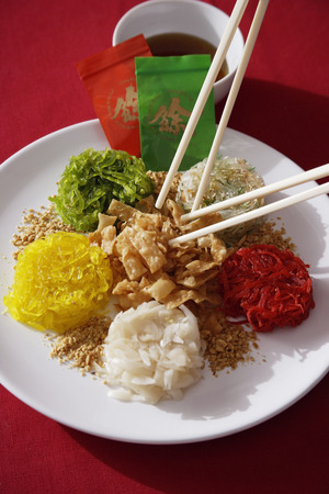 Plate of raw fish salad also known as 'Yu Sheng' or 'Lo Hei'
