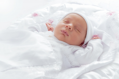 Lovely New Born Baby Sleeping in Bedの写真素材
