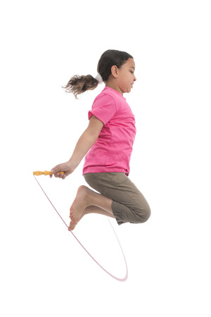 Active Girl Jumping with Skipping Rope Isolated on White Background