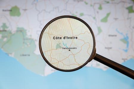 Photo pour Yamoussoukro, Cote d'Ivoire. Political map. City visualization illustrative concept on display screen through magnifying glass. - image libre de droit