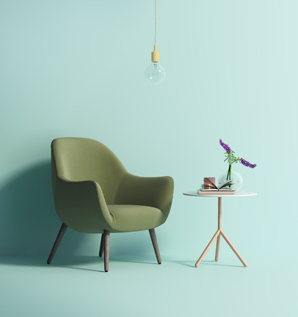 Contemporary green armchair on mint wall