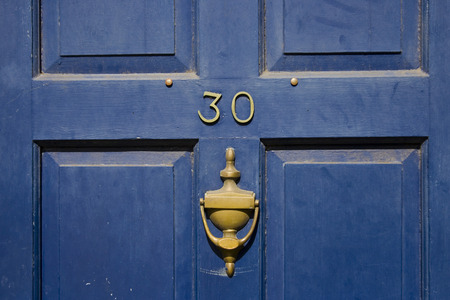 Traditional british residential front door with knocker