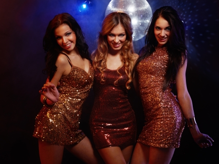 Portrait of dancing girls on disco party