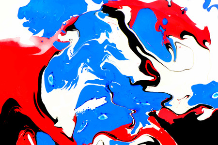 Abstract ink background. Marble style. Red black blue ink in water