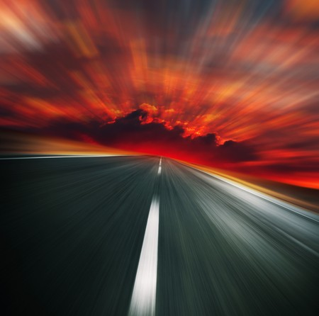Photo pour Blurred asphalt road and red bloody blurred sky - image libre de droit