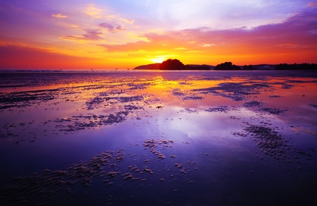 Purple Sunset Over A Beach During Low Tide