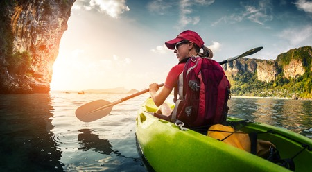 Photo for Young lady paddling kayak - Royalty Free Image