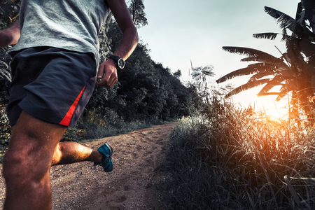 Photo for Man athlete running on the gravel road - Royalty Free Image