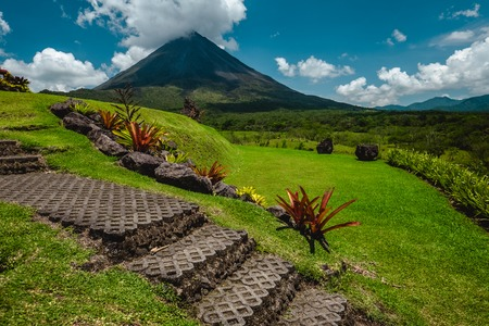 Volcano of Arenal with stone stairs on the foreground at sunny day. Costa Rica