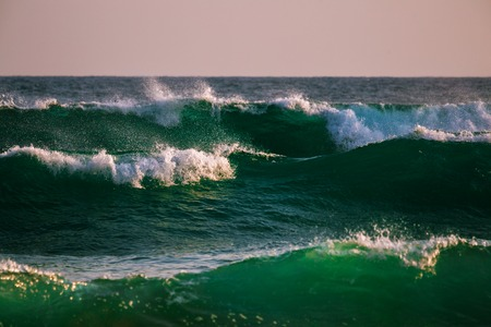Green ocean waves with foam