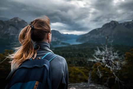 Woman hiker enjoys mountains view during bad weather. Patagonia, Argentina