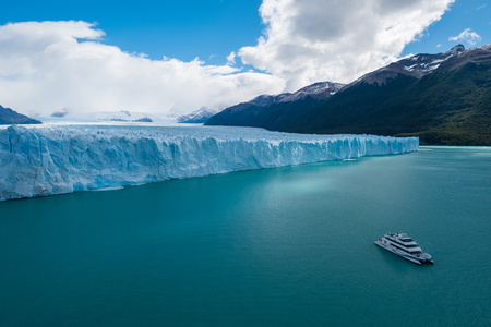 Photo for Front part of the Perito Moreno Glacier located in the Southern Patagonian Ice Field and touristic, day trip boat on the turquoise Lago Argentino. Argentina - Royalty Free Image