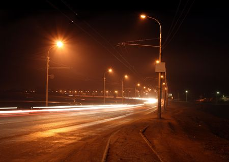 traffic ob night road with street lamps in fog