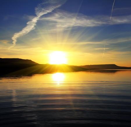 morning lake landscape with sunrise over mountains