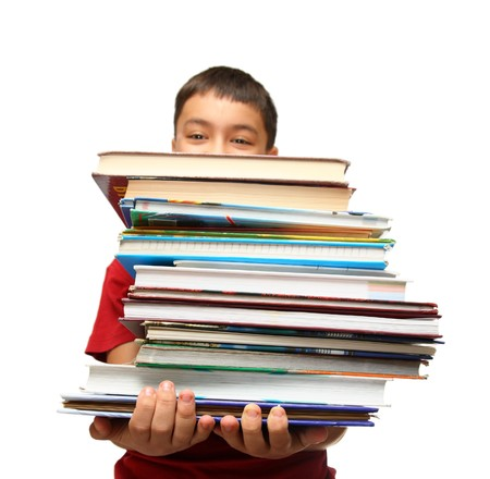 asian boy with heavy stack of books