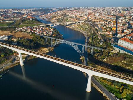 Photo pour Aerial view on bridges and Douro river in Porto at morning, Portugal - image libre de droit