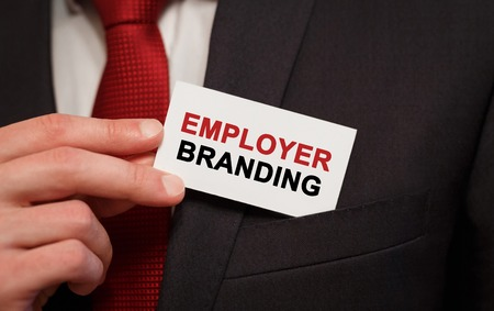 Businessman putting a card with text Employer Branding in the pocket