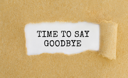 Photo pour Text Time To Say Goodbye appearing behind ripped brown paper. - image libre de droit
