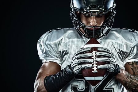 Photo for American football sportsman player in helmet isolated run in action on black background. Sport and motivation wallpaper. Team sports, - Royalty Free Image