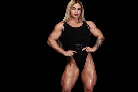 Photo for Woman bodybuilder athlete, on black background. Fitness and sport motivation. - Royalty Free Image