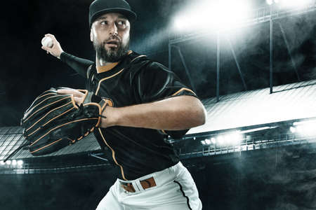 Photo for Porfessional baseball player with ball on grand arena. Ballplayer on stadium in action. - Royalty Free Image