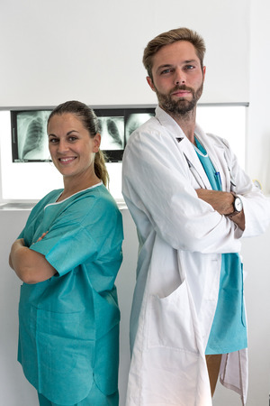 Photo pour group of medical workers in hospital, surgeon and nurse - image libre de droit