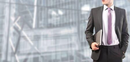 Photo pour relaxed businessman standing at work - image libre de droit
