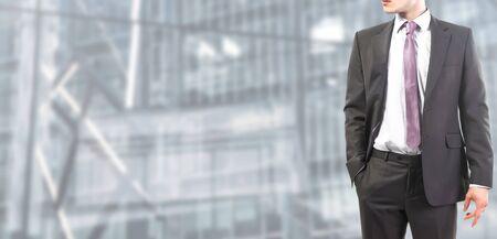 Photo pour Businessman follows and tie standing relaxed - image libre de droit