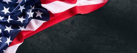 Foto de USA flag on dark wooden table background - Imagen libre de derechos