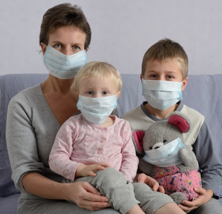 Family in protective masks