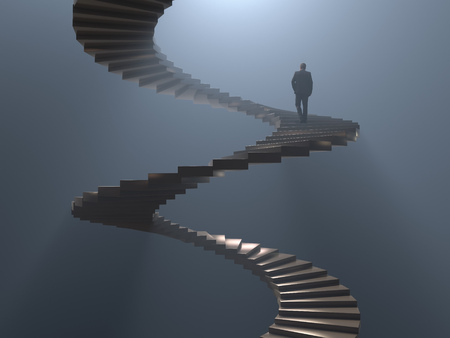 Photo for man climbs the spiral staircase - Royalty Free Image
