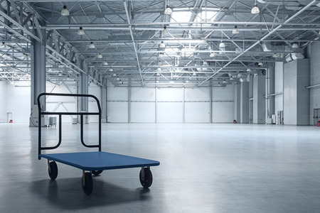 Photo for Interior of empty warehouse with a cart - Royalty Free Image