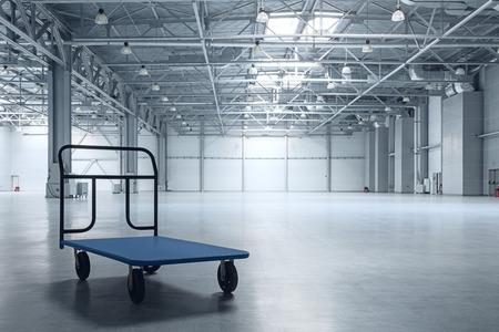 Photo pour Interior of empty warehouse with a cart - image libre de droit