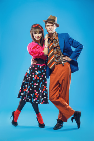 Young couple wearing colorful old-fashion clothes in pinup style. Also they can represent members of a youth counterculture Stilyagi existed from the late 1940s until the early 1960s in the Soviet Union