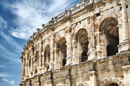 View on the ancient Roman amphitheatre in Nimes city in the Occitanie region of southern France. Magnificent huge arena